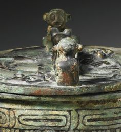 This thoughtfully designed and well-cast small ding vessel belongs to the category of nongqi (playful vessels), which were made for the personal enjoyment of high ranking aristocrats; compare a group of nongqi, unearthed from Hancheng city, Shaanxi province illustrated in Jinyunianhua, Shanxi Hancheng chutu Zhoudai Ruiguo wenwuzhenpin (Golden age of the Rui state: Zhou Dynasty treasures from Hancheng city, Shaanxi province), Shanghai, 2012, pp. 216-217.  A bronze covered liu ding of very…