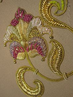 No automatic alt text available. Zardozi Embroidery, Gold Embroidery, Crewel Embroidery, Hand Embroidery Designs, Clay Wall Art, Stars Craft, Gold Work, Dress Sewing Patterns, Fabric Manipulation