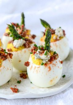 This recipe for Bacon Blue Deviled Eggs with Roasted Garlic and Asparagus may look gourmet but each step is actually very simple. The final product looks beautiful and delicious, making this the perfect finger food for your next spring dinner party.