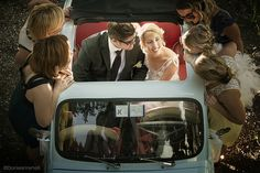 bride & groom in a Fiat 500 as photo prop AND wedding car!