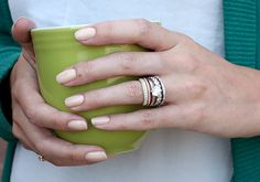 A major wedding ring trend of 2015 isn't about the engagement ring; it's all about the bands! Women are stacking multiple wedding bands of all cuts, settings and metal colors to take this trend to the next level. However, it is not as easy as just putting a band on top of another one. Take a look at our method of completing the perfect stacked wedding set.
