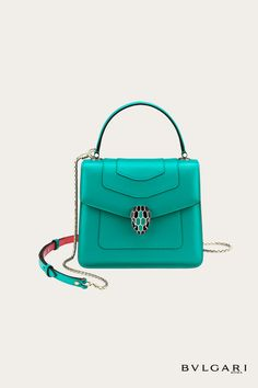 Serpenti Forever crossbody bag in tropical turquoise smooth calf leather body and sea star coral calf leather sides. Snakehead closure in light gold plated brass decorated with tropical turquoise and black enamel, and black onyx eyes.