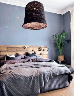 Enchanting blue bedroom with nature inspired headboard and pendant light. Create a calm atmosphere in the bedroom by using soothing blue and brown hues. Timber Bedhead, Timber Beds, Blue Bedroom, Dream Bedroom, Master Bedroom, Bedroom Inspo, Bedroom Decor, Casual Bedroom, Gravity Home