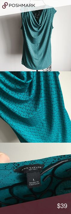 "sleeveless cowl neck top. nwot Never worn. Actual color is slightly more green than in the first picture- other photos make it look tinted more blue than it is. Great, simple black design. 95% polyester and 5% spandex. Measurements lying flat: armpit to armpit 21 inches and length is 26 inches.  ❌ No trades or off Poshmark transactions.   Quick shipping.   Offers welcome through ""Make an Offer"" feature.    Bundle discount.   ❔ Feel free to ask any questions. Ann Taylor Tops"