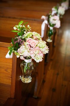 Budvases tied to pews