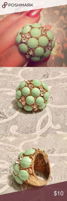 Glam Retro Cocktail Ring With Rhinestones! Fabulous piece of costume jewelry! Mint green adornments set with high quality rhinestones and gold detailing. Can't confirm it's real gold but it certainly seems heavy enough to be so. The perfect cocktail ring for sipping drinks with sparkle! I don't know the size, but my hands/fingers are average size and it fits my ring finger. Jewelry Rings
