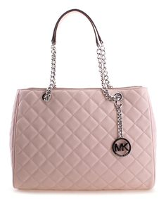 Complete your look with timeless sophistication wearing this elegant quilted tote embellished with gleaming silvertone hardware. A spacious interior keeps your essentials organized. 14'' W x 10.25'' H x 5.25'' D9'' handle dropLeatherMagnetic snap closureThree compartmentsInterior: one zip and four slip pocketsImported