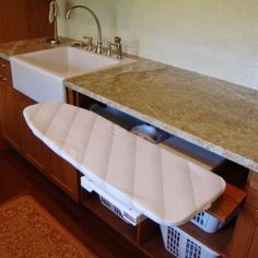 Does Spring Cleaning include organizing solutions? This pull out ironing board is a great idea. #HomeOrganization #HomeSolutions #Laundry #MMCompaniesLLC