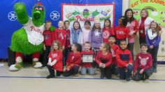 """The Phillie Phanatic surprised the students of Hurffville Elementary with a fun-filled assembly for being top readers in the Be a Phanatic About Reading program on Jan. 11! The Phanatic acted out his book """"Phillie Phanatic's One-Man Band"""" with help from the students and faculty."""