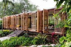 Brillhart Architecture's breezy Brillhart Residence in Miami takes inspiration from Tropical Modernism with wooden shutters. Brillhart Architecture's breezy Brillhart Residence in Miami takes inspiration from Tropical Modernism with wooden shutters. Vernacular Architecture, Modern Architecture House, Architecture Design, Landscape Architecture, Modern Buildings, Beautiful Architecture, Wooden House Design, Wooden Houses, Bamboo House Design