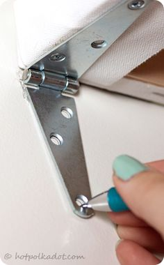 A great way to hide ugly wall fixtures. Perfect for hanging anything. (It also lets you hide your wall-safe) ;]