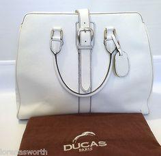 There's nothing like a white Ducas Paris handbag. #Worthilious #luxuryhandbags #DucasParis