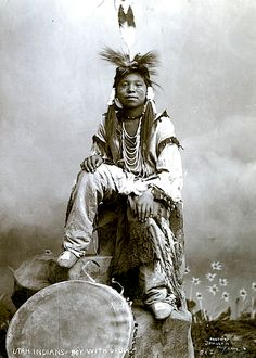 A Ute boy with drum. ca. 1900. Photo by Charles Ellis Johnson.