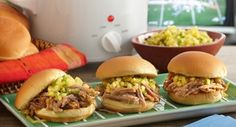 Caribbean Jerk Pulled Pork Sliders: Add spicy island heat to your tailgating or at-home football parties by serving sliders filled with Caribbean jerk pulled pork topped with a tropical...