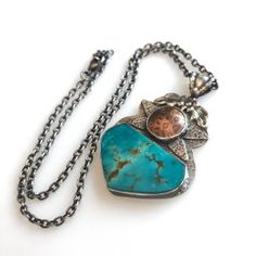 This Kingman Turquoise shares this necklace with a domed oxidized disc.