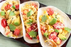 Breakfast Tacos with Avocado...  1/2 T. Olive Oil 1/4 c. diced Onion pinch Salt n Pepper 1 small clove minced Garlic 1/4 c. diced Red Pepper 1/2 diced Jalapeño Pepper 1/2 c. Grape Tomatoes Halves fresh-squeezed Lime Juice 4 beaten Eggs 1/2 c. shredded Cheddar or Jack (recipe plus topping) 4 Flour Tortillas 1 diced Avocado Cilantro garnish Salsa