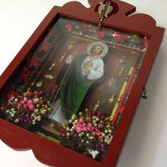 Nichos are wood or metal box-shaped reliquaries usually with an open front. They are meant to be personal devotional altars for home or workplace. They can be simple or ornate, incorporating religious
