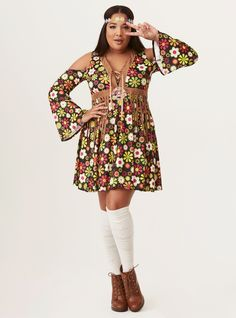 """A swinging 60s dress features a far out floral print, faux suede fringe trim, and a peace sign applique on the bust. Lace-up V-neck Cold shoulder bell sleeves Includes dress and headband Not sold in stores. No in-store returns. Must be returned in original packaging. CONTENT + CARE Polyester Hand wash cold, drip dry Imported plus size costume SIZE + FIT Runs small Model is 5'11"""", size 1X/2X Popular Halloween Costumes, Pirate Halloween Costumes, Couple Halloween Costumes For Adults, Costumes For Teens, Halloween Outfits, Couple Costumes, Group Costumes, Halloween Night, Adult Costumes"""