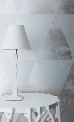 Hixmore Triangles on Sterling Silver gilded paper. Interior design by Tara Craig.