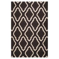 Artfully handcrafted for chic, long-lasting style, this beautiful rug brings a touch of indulgence to your home.  Product: RugConstruction Material: 100% WoolColor: Black and creamFeatures:  Hand-wovenFlatweaveMade in IndiaPart of the Jill Rosenwald Collection Note: Please be aware that actual colors may vary from those shown on your screen. Accent rugs may also not show the entire pattern that the corresponding area rugs have.Cleaning and Care: Blot stains