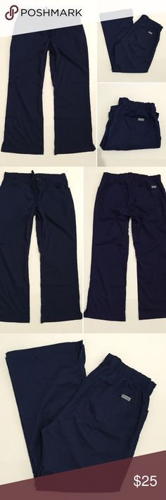 """[Grey's Anatomy] women's navy blue scrub pants MP [Grey's Anatomy] women's blue scrub pants MP (medium petite) •🆕listing •great pre-owned condition •navy blue color •3 front, 2 back •drawstring, back elastic waistband •material 77% polyester 23% rayon •length/inseam 29"""" •offers and bundles welcomed using the features Grey's Anatomy  Pants"""