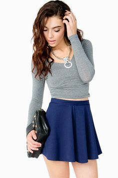 An essential piece to any fashionista's closet, this lightweight crop top features a scoop neck and back. Long sleeves. Looks rad with a skater skirt and boots.