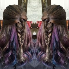 Hidden colors of space purple and blue in between hair layers.