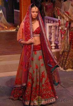Stunning red and sea form green lehenga from Tarun Tahiliani bridal couture collection.