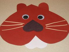 Happy Groundhog's Day!! Here is a cute groundhog made mostly of hearts. You will need a large brown heart for the head, a small white hear...