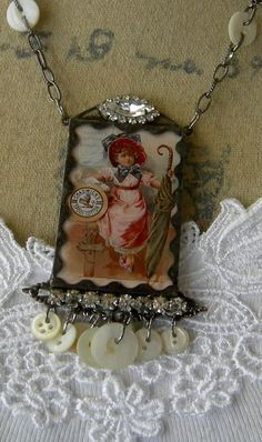 Chadwick Thread is an adorable shabby chic soldered glass necklace that I made from a vintage trade card which has been reduced in size and printed on magnificent iridescent photo paper. The image features a charming little girl in pink and blue and is from an 1890s card from my collection of vintage ephemera. The photo of the necklace just cant do justice to the dreamy quality of the paper. It has been copper foil wrapped and soldered on to a pair of bronze colored filigrees. A vintage…