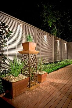 Have you just bought a new or planning to instal landscape lighting on the exsiting house? Are you looking for landscape lighting design ideas for inspiration? I have here expert landscape lighting design ideas you will love. Outdoor Privacy, Backyard Privacy, Backyard Fences, Backyard Drainage, Landscaping Around Trees, Backyard Landscaping, Landscaping Ideas, Backyard Ideas, Privacy Fence Landscaping