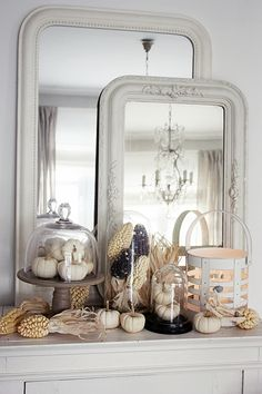 Layered Mirrors and Pumpkins Under Glass by White Living, Fall Decor Inspiration. Stunning homes decorated for Fall. Lots of pictures full of ideas.
