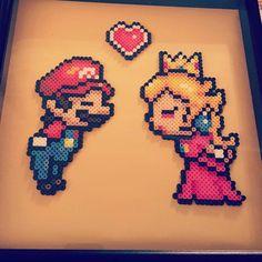 Super Mario and Princess Peach perler beads by kupkakekhaos