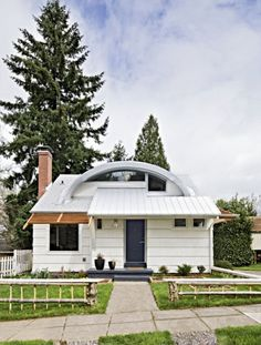 Portland, Oregon - The front of the home draws you in with its curved roofline