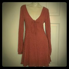 NWOT Fp Textured Long Sleeve Dress Beautiful never worn textured longsleeve dress by Free People . Has a low cut knot tie in the middle and a deep v in the back.  Is super cute and flattering. Is a kinda of pinky taupe. 3rd picture does the color the justice. Free People Dresses Long Sleeve