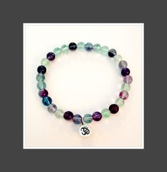 Rainbow Fluorite Om Bracelet     To purchase:  DM, email:  shinebrightjewelrydesigns@gmail.com or visit our Etsy store.    https://www.etsy.com/shop/ShineBrightDesign?ref=ss_profile