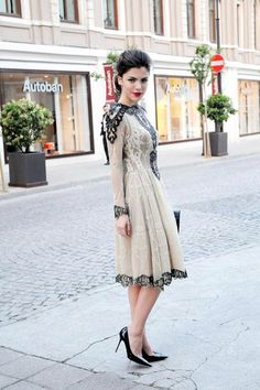 Love the detailed embellishment and beading on this sleeved midi dress