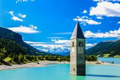 tower of sunken church in Resia lake, South Tyrol, Italy Machu Picchu, Visit Austria, South Tyrol, Adventure Is Out There, Tower Bridge, Travel Around, Places To See, World, Building