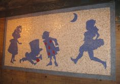 Mosaic murals of Alice, the Mad Hatter, and other characters can be found underground on the 1 train platform in the 50th Street subway station, NYC