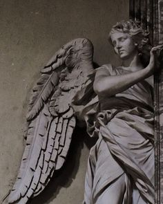 Vatican angel woman with beautiful wings staring at the world