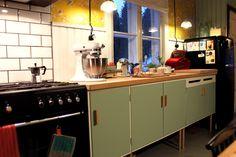 Mint green kitchen cabinets // via Riuttala Old School
