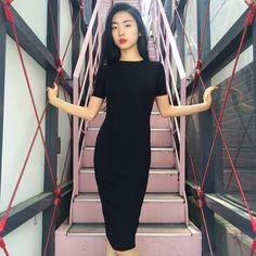 Yuri wears the new Ponte Pencil Mid-Length Dress.
