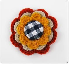 Crocheted brooch with a covered button.Approximately 2,4 inches in diameter.Customize your coats, jackets, hats, purses, with it!
