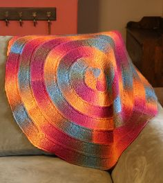 Free Knitting Pattern for Ten Stitch Twist Blanket - This circular version of Frankie Brown's Ten Stitch Blanket is knit in a garter stitch spiral with only ten stitches and virtually no sewing up. Any yarn and needles can be used though it's great for multi-color yarn or stashbusting! Pictured project by bugsknitty