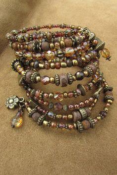 Awesome boho bracelet! Etsy listing at https://www.etsy.com/listing/226976726/earthly-brown-red-rust-boho-bracelet