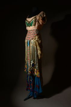 Evening ensemble by Jeanne Paquin, summer 1912, Drouot Richelieu. This richly embroidered, Russian-inspired dress was based on the drawings of Russian painter Léon Bakst, who famously designed numerous costumes and sets for the Ballets Russes. The dress dates to the same time as the premiere of Daphnis and Chloë, a Ballets Russes production, at the Théâtre du Châtelet on June 8, 1912.