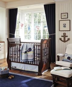 Nautical Baby Nursery (I like the wall art on the right - cute with the anchor and the photos)