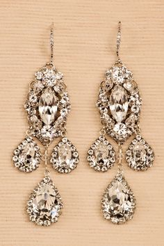 These wow-factor chandelier earrings have a distinct Genevarhinestone style. By Haute Bride, EC929. Chandelier measures a 3 inch drop Made to Order in 6-8 weeks Made with ❤in the USA