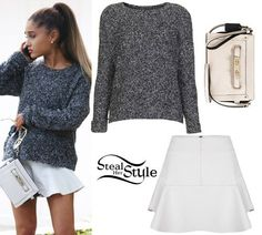 Ariana Grande was spotted in Los Angeles last week wearing a Topshop Gray Boucle Slouchy Jumper (Sold Out), the SuperTrash Sudo Skirt ($135.00) and a Coach Designer Swagger Colorblock Wristlet ($275.00).