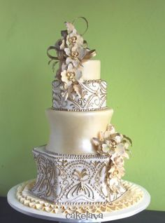 Gold wedding cake with phalaenopsis orchids